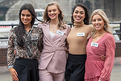 © Licensed to London News Pictures. 21/11/2019. London, UK. Miss Northern Ireland (Lauren eve LECKEY), Miss Wales (Gabriella JUKES), Miss England (Bhasha MUKHERJEE) and Miss Scotland (Keryn MATTHEW) pictured at Tower Bridge. National representatives from around the world arrive in London for the 69th Miss World festival and final Photo credit: Peter Manning/LNP