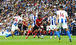 Manchester United's Jesse Lingard (centre) in action during the Premier League match at the AMEX Stadium, Brighton.