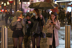 Licensed to London News Pictures. 03/10/2020. London, UK. Revellers making their way home on Saturday night in Soho, central London - after the 10pm curfew early closing of pubs and bars. Photo credit: Marcin Nowak/LNP