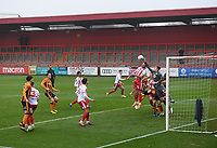 Football - 2020 / 2021 Emirates FA Cup - Round 2 - Stevenage vs Hull City - Lamex Stadium<br /> <br /> Stevenage's Danny Newton and Jamie Cumming under pressure from a Hull corner.<br /> <br /> COLORSPORT/ASHLEY WESTERN