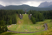 Landscape showing the ski jump for the 1956 Olympics in the city of Cortina d'Ampezzo, Veneto, Italy. Although Cortina was unable to go ahead with the scheduled 1944 Winter Olympics because of the Second World War, it hosted the Winter Olympics in 1956 and subsequently a number of world winter-sports events. Cortina d'Ampezzo commonly referred to as Cortina, is a town and comune in the heart of the southern (Dolomitic) Alps in the Veneto region of Northern Italy.