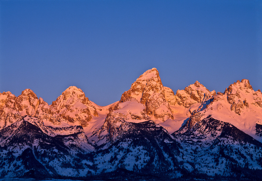 Open Edition Numbered Prints   The Teton Mountain Range just outside Jackson Hole Wyoming is also close to Yellowstone National Park with the tallest peak the Grand Teton at 13,770 ft (4,197 m) seen on cold winter sunrise morning
