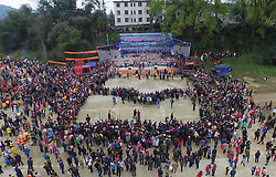 Photo taken on March 10, 2016 shows an aerial view of local people and visitors watching a performance celebrating a traditional festival, which falls on the second day of the second month in the Chinese lunar calendar, in Meilin Township under Dong Autonomous County of Sanjiang, south China's Guangxi Zhuang Autonomous Region. EXPA Pictures © 2016, PhotoCredit: EXPA/ Photoshot/ Huang Xiaobang<br /> <br /> *****ATTENTION - for AUT, SLO, CRO, SRB, BIH, MAZ, SUI only*****