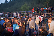 Turkish families and friends wait for news of survivers as bodies are pulled from the mine. An explosion caused by an electrical fault has left more than 238 Turkish miners dead and tens injured. Soma, Turkey.