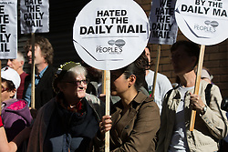 © licensed to London News Pictures. London, UK 06/10/2013. Demonstrators protest against the hating of Britain by the Daily Mail newspaper outside the publication's head office in Kensington, London on 6 October 2013. Photo credit: Vickie Flores/LNP.