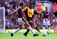 Paolo Di Canio (West Ham United) Rigobert Song (Liverpool). West Ham United 1:1 Liverpool, F.A. Carling Premiership, 17/9/2000. Credit: Colorsport / Stuart MacFarlane.