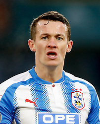 """Huddersfield Town's Jonathan Hogg during the Premier League match at the John Smith's Stadium, Huddersfield. PRESS ASSOCIATION Photo. Picture date: Saturday January 13, 2018. See PA story SOCCER Huddersfield. Photo credit should read: Martin Rickett/PA Wire. RESTRICTIONS: EDITORIAL USE ONLY No use with unauthorised audio, video, data, fixture lists, club/league logos or """"live"""" services. Online in-match use limited to 75 images, no video emulation. No use in betting, games or single club/league/player publications"""
