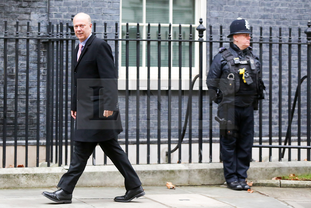 "© Licensed to London News Pictures. 18/12/2018. London, UK. Chris Grayling - Secretary of State for Transport arrives in Downing Street for the weekly Cabinet meeting. The Cabinet will discuss the preparations for a ""No Deal"" Brexit. Photo credit: Dinendra Haria/LNP"