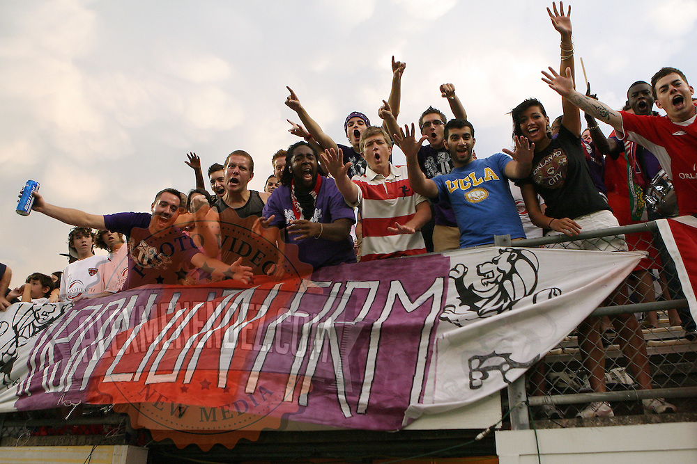 Orlando City fans cheer during a United Soccer League Pro soccer match between the Wilmington Hammerheads and the Orlando City Lions at the Florida Citrus Bowl on June 18, 2011 in Orlando, Florida.  (AP Photo/Alex Menendez)