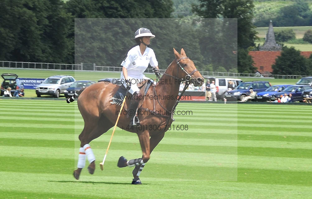 KATIE PRICE - model Jordan, playing polo at a Pro-Celebrity Polo match in aid of the Mark Davies Injured Riders Fund Charity Day held at Cowdray Park, West Sussex on 22nd June 2008.<br /><br />NON EXCLUSIVE - WORLD RIGHTS