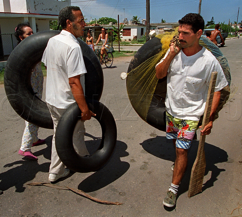 8/1994-Al Diaz/Miami Herald--People blatantly defied the Revolution. In most cases, Fidel Castro's coast guard turned a blind eye to those trying to leave. Many walked down the streets of Cojimar, Cuba with inner tubes. If a man was detained one day, he was able to leave the next.