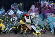 Floral tributes and messages of condolence following the death of Prince Philip, Duke of Edingburgh outside Buckingham Palace on 11th April 2021 in London, United Kingdom. Members of the public have been laying flowers outside the gates of the royal residence following his passing at the age of 99 on 9th April 2021. Prince Philip, Duke of Edinburgh was a member of the British royal family as the husband of Elizabeth II. Philip was born into the Greek and Danish royal families.
