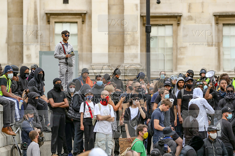 BLM protesters gesture as they confront far-right group and British police officers at Trafalgar Square in central London, during a counter-protest against a Black Lives Matter demonstration, Saturday, June 13, 2020. British police have imposed strict restrictions on groups planning to protest in London Saturday in a bid to avoid violent clashes between protesters from the Black Lives Matter movement, as well as far-right groups. (Photo/ Vudi Xhymshiti)