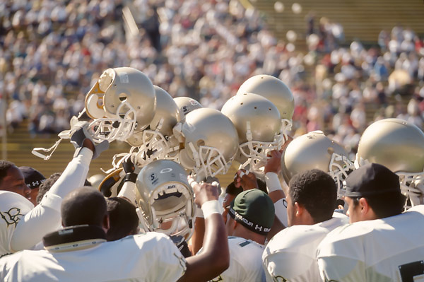 BERKELEY, CA -  OCTOBER 12:   Members of the Long Beach Poly High School football team raise their helmets prior to a game against the Concord De La Salle Spartans played on October 12, 2002 in Memorial Stadium at the University of California at Berkeley, California.  De La Salle won by a final score of 28-7, their 130th straight victory.  (Photo by David Madison/Getty Images)