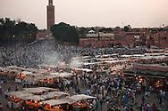 Koutoubia Mosque behind marketplace at Place Jemma el-Fna, Marrakesh, Morocco