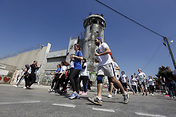 March 22, 2019 - Bethlehem, West Bank, Palestinian Territory - Palestinian and foreign activsts take part in the Palestine Marathon, in the West Bank city of Bethlehem, Friday, March 22, 2019. Palestine seventh international marathon kicked off this morning in Bethlehem with the participation of 8000 runners from 76 countries, with a 51.7 percent of women participants, according to the marathon organizers  (Credit Image: © Wisam Hashlamoun/APA Images via ZUMA Wire)