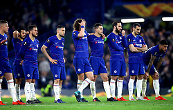 Chelsea players react whilst watching the penalty shoot out during the UEFA Europa League, Semi Final, Second Leg at Stamford Bridge, London.