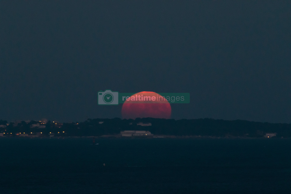 A supermoon rises up from behind the Eden Roc palace hotel in Cap DíAntibes, southern France, on November 14, 2016. The most spectacular supermoon since 1948 lights up the sky on Tuesday morning and evening, appearing 14 per cent bigger and 30 percent brighter than usual. November's supermoon, a term used to describe a full moon is at its perigee or closest point to Earth during the lunar orbit, will be the biggest and brightest supermoon to rise in almost 69 years. A full moon won't come this close to Earth again until November 25, 2034. Photo by Philippe Farjon/ABACAPRESS.COM