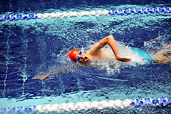 Swimmer in a swimming gala race UK