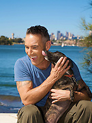 Anthony Field with dogs Butch [ Brown] & Misty [ White] from the RSPCA Animal Rescue at Rea Reserve, Drummoyne, Sydney..Pics Paul Lovelace 15.04.09