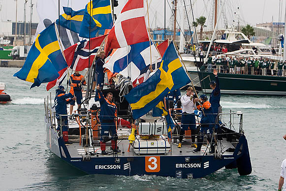 © Sander van der Borch.Alicante, 11 October 2008. Start of the Volvo Ocean Race. Ericsson 3 waving leaving the dog with every crew member waving his own national  flag.