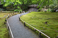 """Hogon-in was built as a sub-temple of Tenryu-ji.  Like many Kyoto temples, it was damaged by the fires of the Onin war. It was reconstructed in the 16th century and moved to its present location in Arashiyama.   The temple's zen garden """"The Garden of the Lion's Roar"""".  The temple enshrines many statues of Kannon, as well as another set of statues Arashiyama Arhats - disciples of Buddha.  There are 500 Arhats if you have the time you to count."""