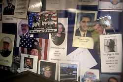 April 25, 2014 - Atlantic Ocean, Florida, U.S. - Funeral cards of people who died as a result of the events on September 11, 2001, sit in a glass case in the Chief's mess area onboard the USS New York on Sunday, April 27, 2014. Reminders of the attack on the Twin Towers are present throughout the ship which keeps the experience ever-present in the minds and mission of the crew. (Credit Image: © Madeline Gray/The Palm Beach Post/ZUMAPRESS.com)