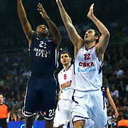 Anadolu Efes's Alfred Jamon Lucas (L) and CSKA Moscow's Nenad Krstic (R) during their Euroleague Top 16 game 8 basketball match Anadolu Efes between CSKA Moscow at the Abdi Ipekci Arena in Istanbul at Turkey on Friday, February, 22, 2013. Photo by TURKPIX