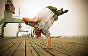 Young male breakdancing in the middle of a jump
