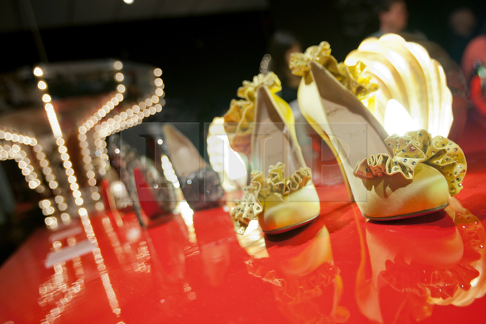 © licensed to London News Pictures. London, UK 30/04/2012. Shoes designed by Christian Louboutin shown at his new exhibition which celebrating 20 years of the famous red soled footwear brand at Design Museum in London. Photo credit: Tolga Akmen/LNP