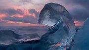 A beautiful iceberg at dawn on Jökulsárlón beach.