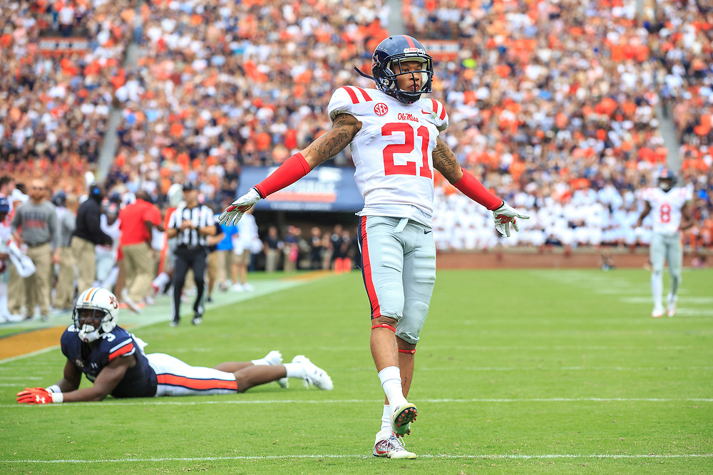 Mississippi Rebels defensive back Javien Hamilton (21) celebrates breaking up a pass intended for Auburn Tigers wide receiver Nate Craig-Myers (3) during an NCAA football game, Saturday, October 7, 2017, in Auburn, AL. Auburn won 44-23. (Paul Abell via Abell Images for Chick-fil-A Peach Bowl)