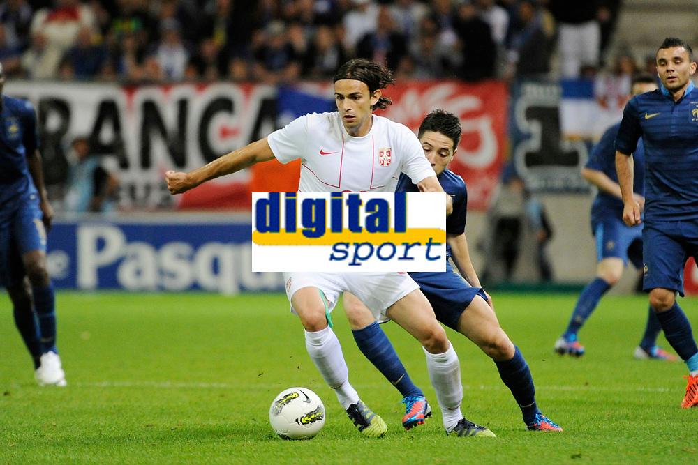 FOOTBALL - FRIENDLY GAME 2012 - FRANCE v SERBIA - REIMS (FRANCE) - 31/05/2012 - PHOTO JEAN MARIE HERVIO / REGAMEDIA / DPPI - IVAN RADOVANOVIC (SER) / SAMIR NASRI (FRA)