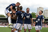 Andreas Bouhalakis of Nottingham Forest (2nd left) is mobbed by teammates as he celebrates after scoring his team's third goal. EFL Skybet football league championship match, Brentford  v Nottingham Forest at Griffin Park in London on Saturday 12th August 2017.<br /> pic by Steffan Bowen, Andrew Orchard sports photography.