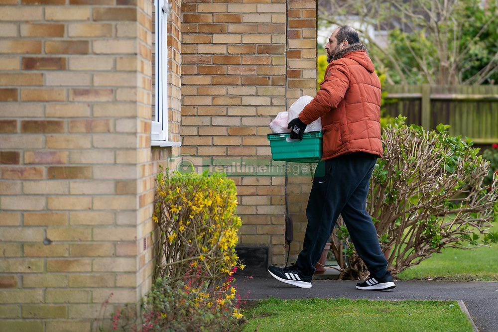Tony Rosa delivers food packages from Enfield Council to the vulnerable in Enfield, north London.