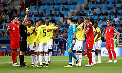 Referee Mark Geiger shows a yellow card to Colombia's Wilmar Barrios after head butting England's Jordan Henderson during the FIFA World Cup 2018, round of 16 match at the Spartak Stadium, Moscow.