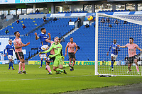 Football - 2020 / 2021 Premier League - Brighton and Hove Albion vs. Sheffield United - The Amex Stadium<br /> <br /> Alireza Jahanbakhsh of Brighton heads past the outstretched arms of Aaron Ramsdale of Sheffield United only for his header to crash against the bar during the Premier League match at The Amex Stadium Brighton <br /> <br /> COLORSPORT/SHAUN BOGGUST