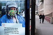 Vaccine promotion poster from the British Red Cross as the national coronavirus lockdown three continues on 5th March 2021 in London, United Kingdom. With the roadmap for coming out of the lockdown has been laid out, this nationwide lockdown continues to advise all citizens to follow the message to stay at home, protect the NHS and save lives, and the streets of the capital are quiet and empty of normal numbers of people.