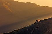 Mountain hut at sunset time