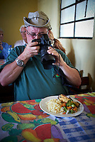 Rob Documenting his Lunch in San Francisco de Sales.  Pacaya Volcano National Park. Image taken with a Leica X1 (ISO 200, 24 mm, f/2.8, 1/30 sec). Raw image processed with Capture One Pro and Photoshop CS5. .