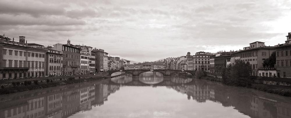 Santa Trinita and Ponte Vecchio reflecting in the Arno river- Florence, Italy.