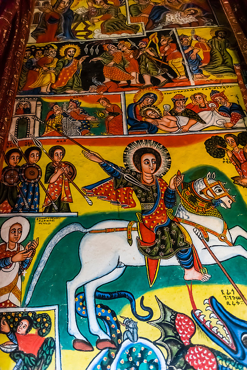 Ura Kidane Mehret (church of the Ethiopian Orthodox Church), on the Zege Peninsula, Lake Tana, Ethiopia.                                             The church dates back to the 16th century and typical of churches in Ethiopa, Ura Kidane Mehret is circular in shape on the outside. Inside, the actual chapel is six sided and the walls on all six sides are beautifully painted frescoes depicting various scenes from biblical lore and the history of the Ethiopian Orthodox Church.