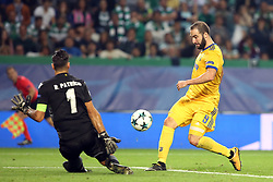 October 31, 2017 - Lisbon, Portugal - Juventus' Argentine forward Gonzalo Higuain (R ) shoots to score during the UEFA Champions League football match Sporting CP vs Juventus at the Alvalade stadium in Lisbon, Portugal on October 31, 2017. (Credit Image: © Pedro Fiuza/NurPhoto via ZUMA Press)