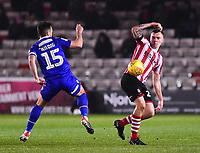 Lincoln City's Harry Anderson vies for possession with Morecambe's Aaron Wildig<br /> <br /> Photographer Andrew Vaughan/CameraSport<br /> <br /> The EFL Sky Bet League Two - Saturday 15th December 2018 - Lincoln City v Morecambe - Sincil Bank - Lincoln<br /> <br /> World Copyright © 2018 CameraSport. All rights reserved. 43 Linden Ave. Countesthorpe. Leicester. England. LE8 5PG - Tel: +44 (0) 116 277 4147 - admin@camerasport.com - www.camerasport.com