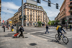 People wear protective masks in Milan, Italy on April 18, 2020. Daily life scenes with the new anti-COVID-19 Coronavirus prevention measures. Photo by Carlo Cozzoli/IPA/ABACAPRESS.COM
