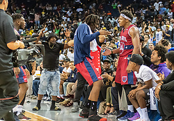July 6, 2018 - Oakland, CA, U.S. - OAKLAND, CA - JULY 06: David Hawkins (34) of Tri-State gets some love from teammate Amar'e Stoudamire (1) co-captain of Tri-State after winning game 3 in week three of the BIG3 3-on-3 basketball league on Friday, July 6, 2018 at the Oracle Arena in Oakland, CA(Photo by Douglas Stringer/Icon Sportswire) (Credit Image: © Douglas Stringer/Icon SMI via ZUMA Press)