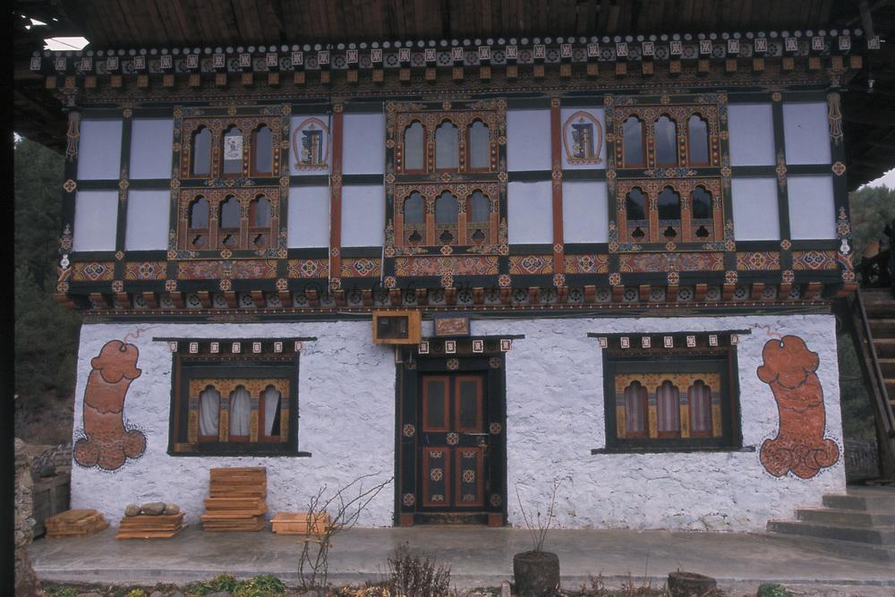 Farm House with Fertility Symbols<br />Central BHUTAN