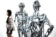 "A chinese woman walks through the sculptures of  the series ""Selection from Venetians"" by artist Pawel Althamer during an exhibition at UCCA Ullens Center for Contemporary Art in 798 Art Disctrict in Beijing, China, August 18, 2014. <br /> <br /> 798 Art District (Chinese: 798艺术区; pinyin: 798 Yìshùqū), or Dashanzi Art District, is a 50-year old decommissioned military factory buildings with unique architectural style. Located in Chaoyang District of Beijing, that houses a thriving artistic community. Since the beginning of 2000, 798 has become a centre for art galleries, artists's ateliers and contemporary arts exhibitions. The buildings are within alleys number 2 and 4 on Jiǔxiānqiáo Lù (酒仙桥路), south of the Dàshānziqiáo flyover (大山子桥). <br /> <br /> © Giorgio Perottino"
