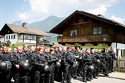 05.06.2015, Garmisch Partenkirchen, GER, G7 Gipfeltreffen auf Schloss Elmau, Circa 300 Menschen demonstrieren in Garmisch-Patenkirchen gegen den G7-Gipfel im benachbarten Elmau, im Bild Polizisten vor Bauernhaus in Garmisch-Patenkirchen // during Protest of the G7 opponents prior to the scheduled G7 summit which will be held from 7th to 8th June 2015 in Schloss Elmau near Garmisch Partenkirchen. Garmisch Partenkirchen, Germany on 2015/06/05. EXPA Pictures © 2015, PhotoCredit: EXPA/ Eibner-Pressefoto/ Gehrling<br /> <br /> *****ATTENTION - OUT of GER*****