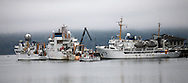 Coast Guard Boat dwarfed by NOAA ships.